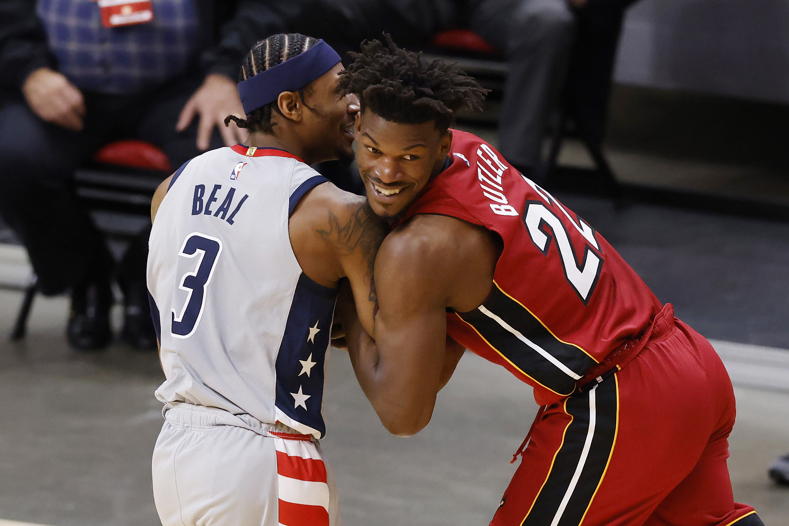 Bradley Beal of the Washington Wizards and Jimmy Butler of the Miami Heat battle for the ball