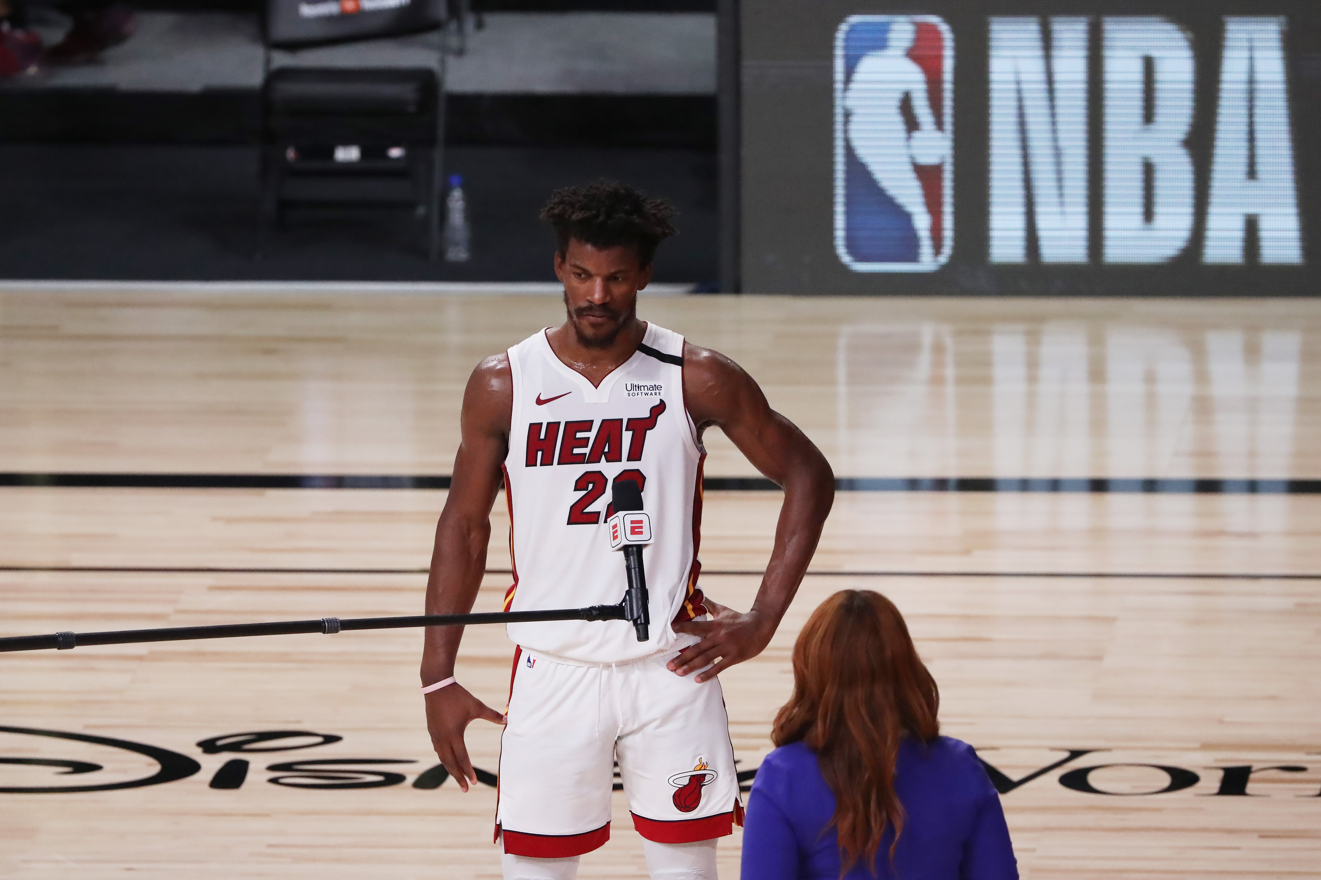 Forward Jimmy Butler speaks to a reporter