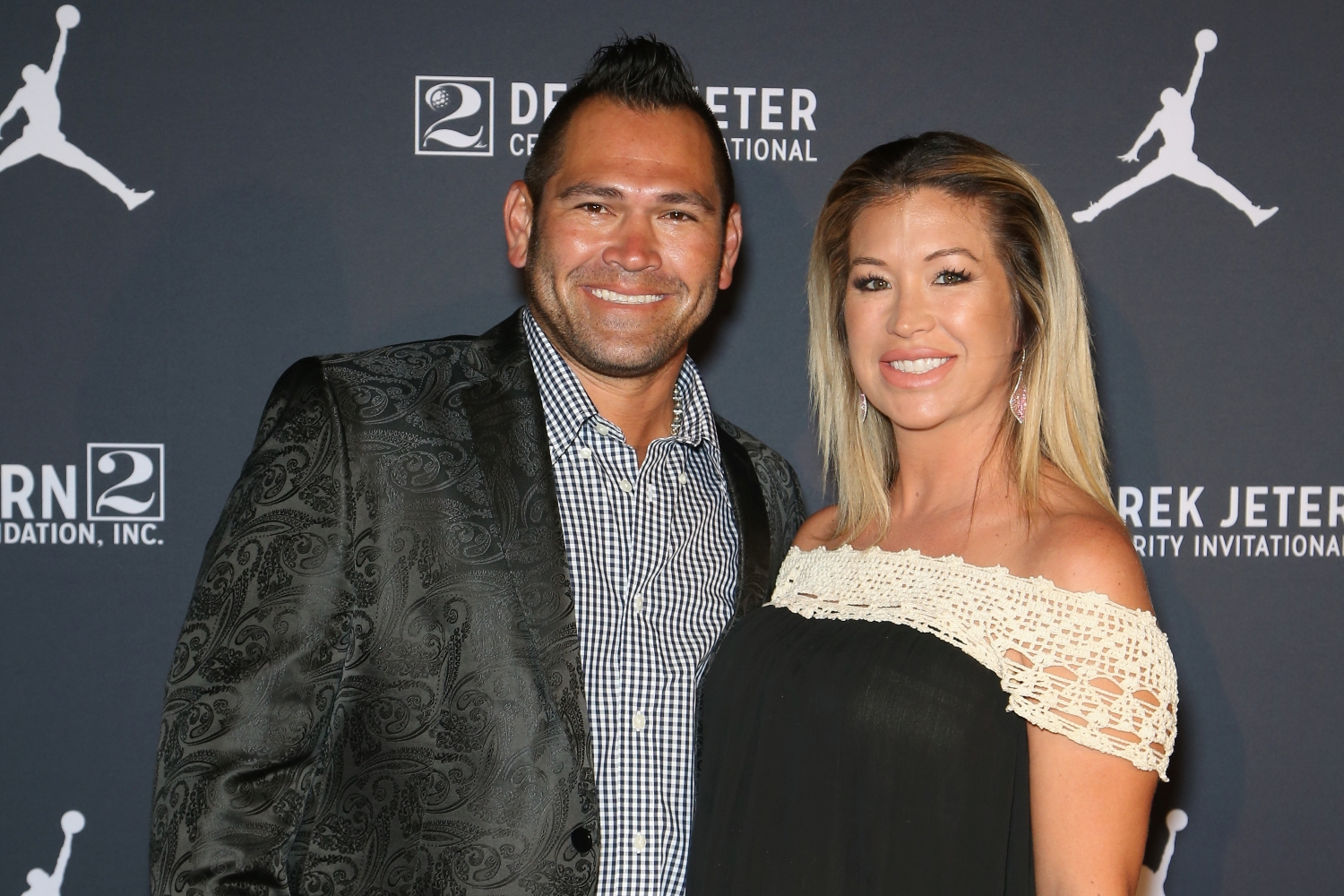 Former MLB player Johnny Damon and his wife, Michelle Damon, arrive at the Liquid Pool Lounge for the kickoff of Derek Jeter's Celebrity Invitational at the Aria Resort & Casino.