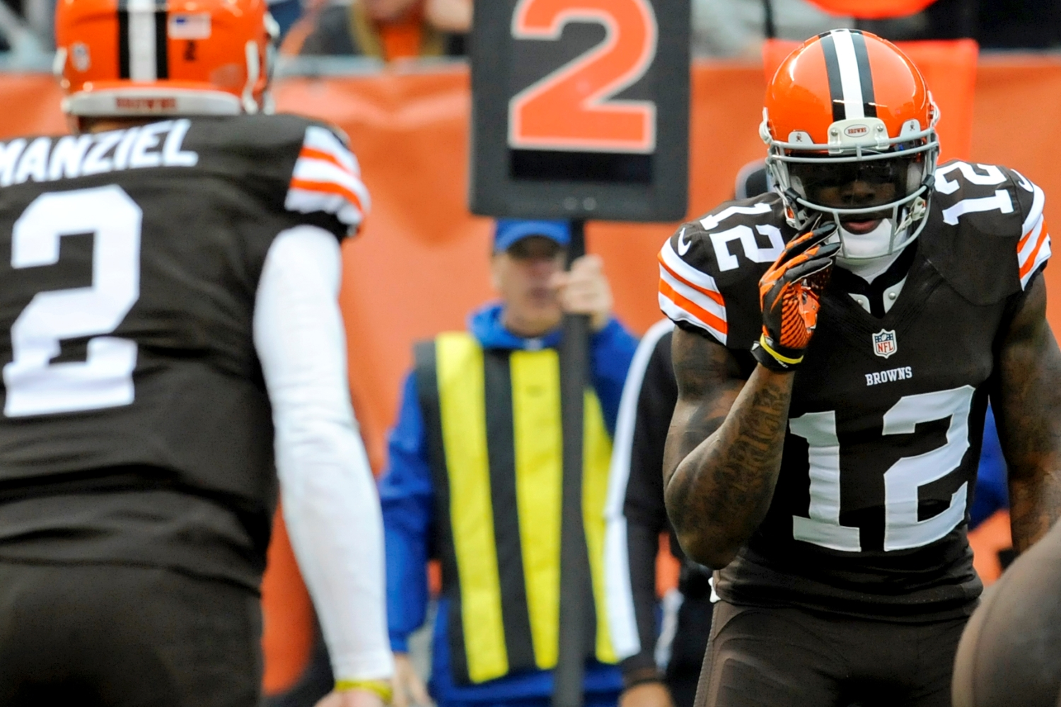 Josh Gordon of the Cleveland Browns listens to a call from quarterback Johnny Manziel in the second quarter of a game against the Cincinnati Bengals.