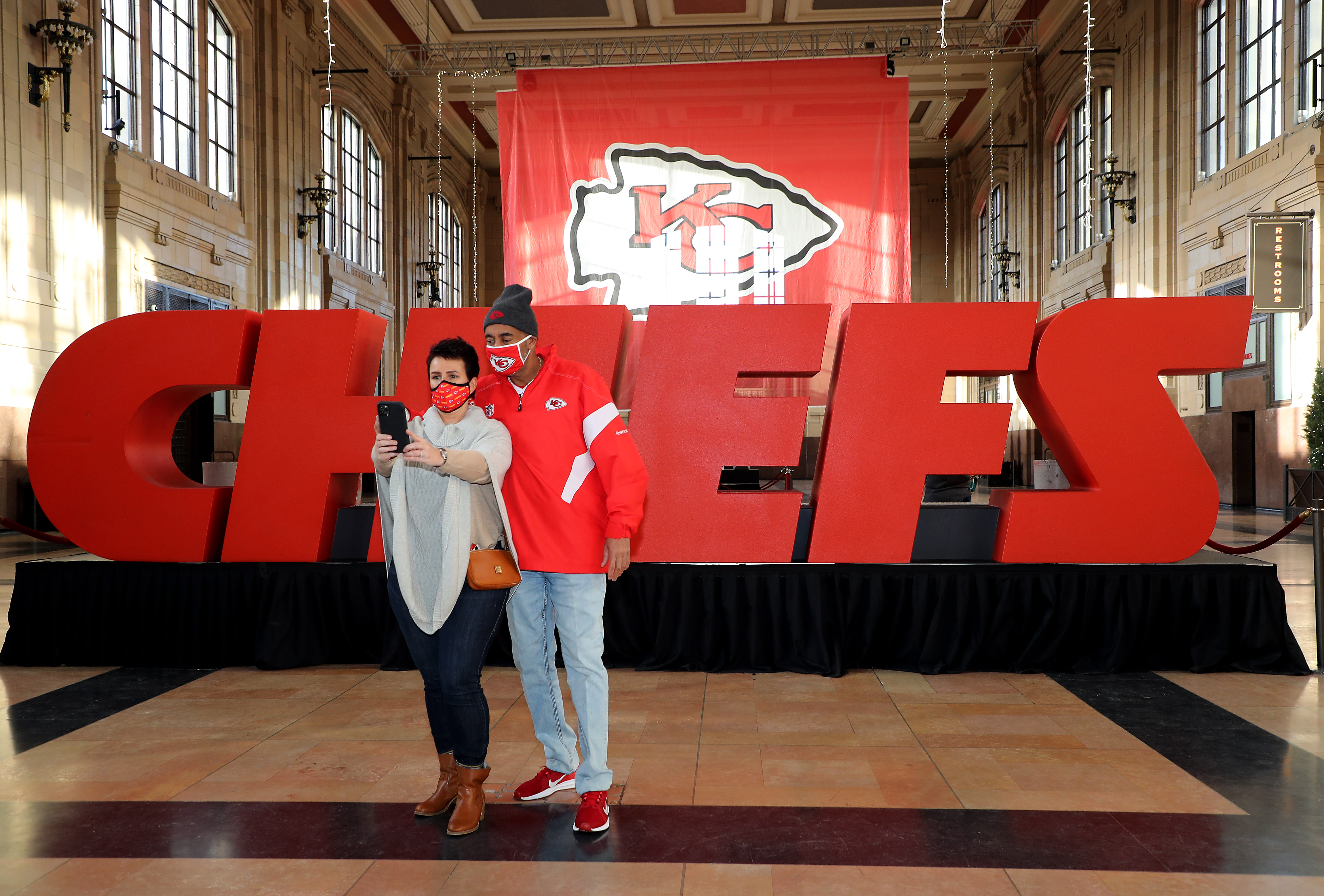 Chiefs fans pose for a selfie before Super Bowl LV