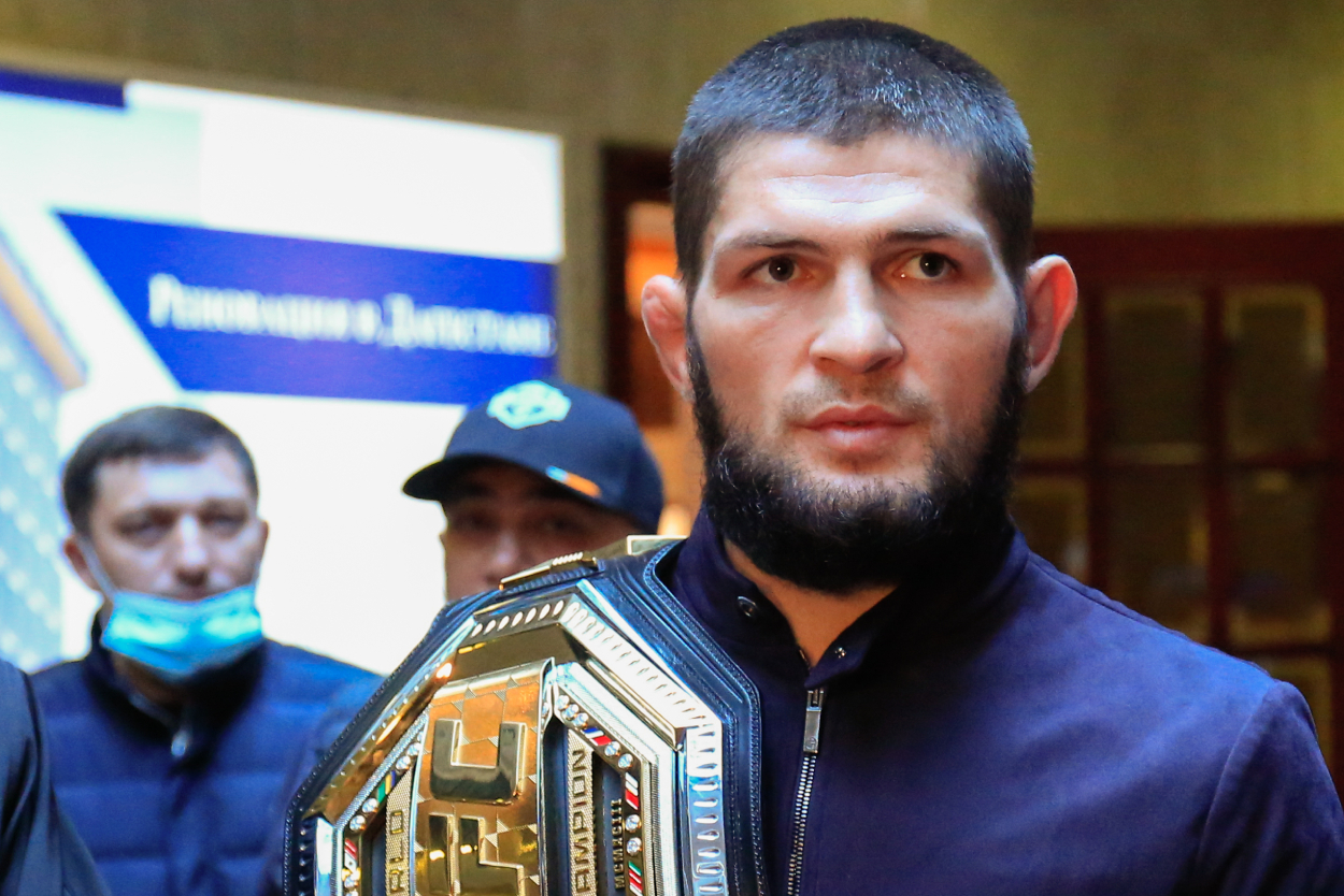 Khabib Nurmagomedov looks on while holding his championship belt