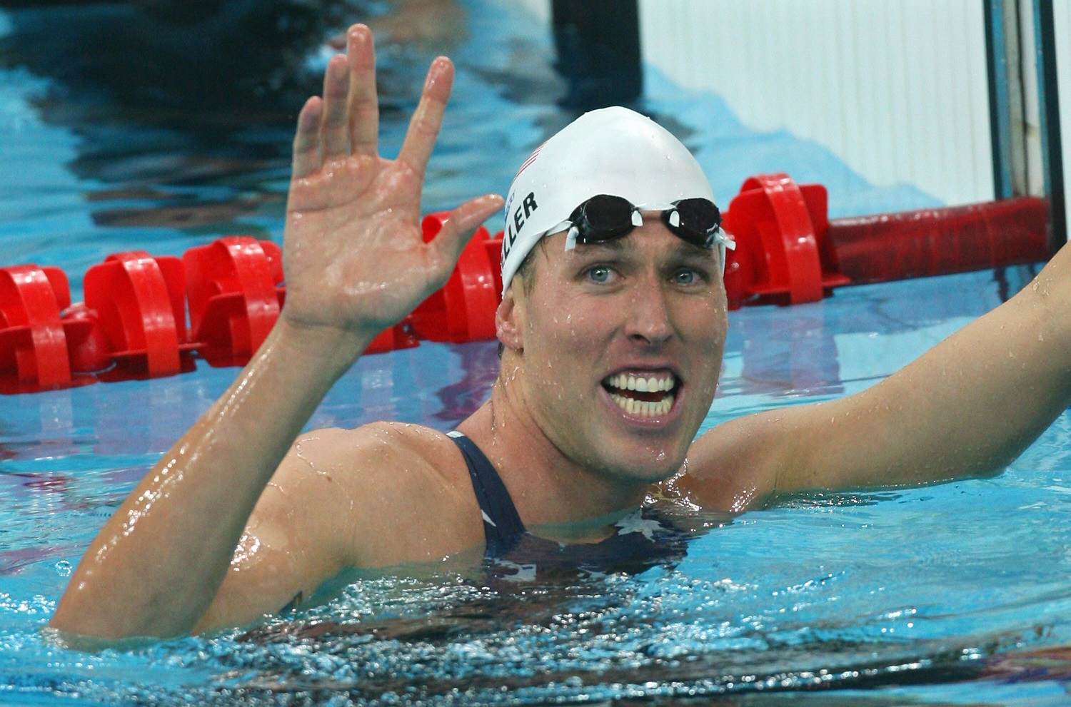 U.S. swimmer Klete Keller reacts to winning the men's 800-meter freestyle relay at the 2008 Beijing Olympic Games