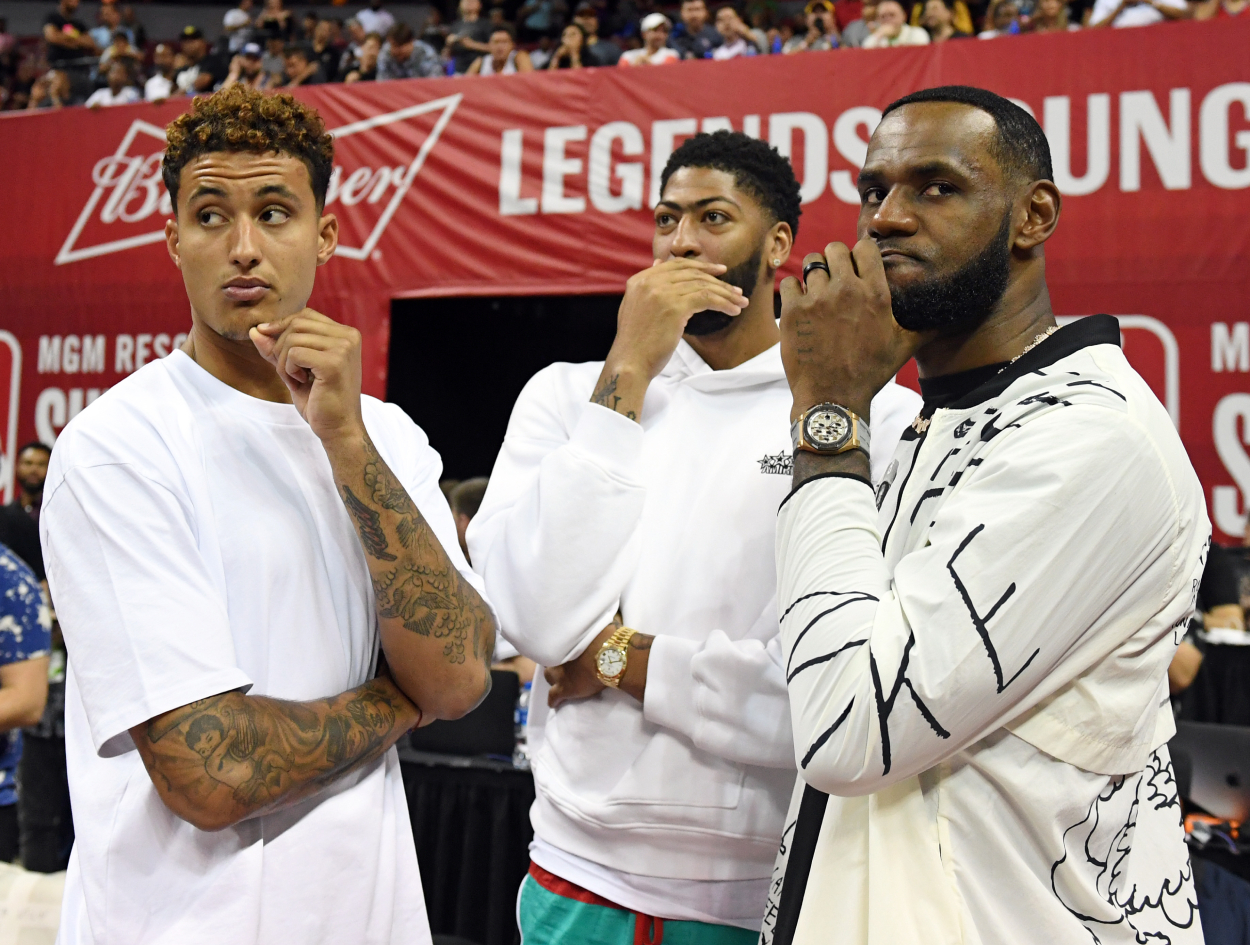 Kyle Kuzma (from left), Anthony Davis, and LeBron James of the LA Lakers talk before a 2019 Summer League game.