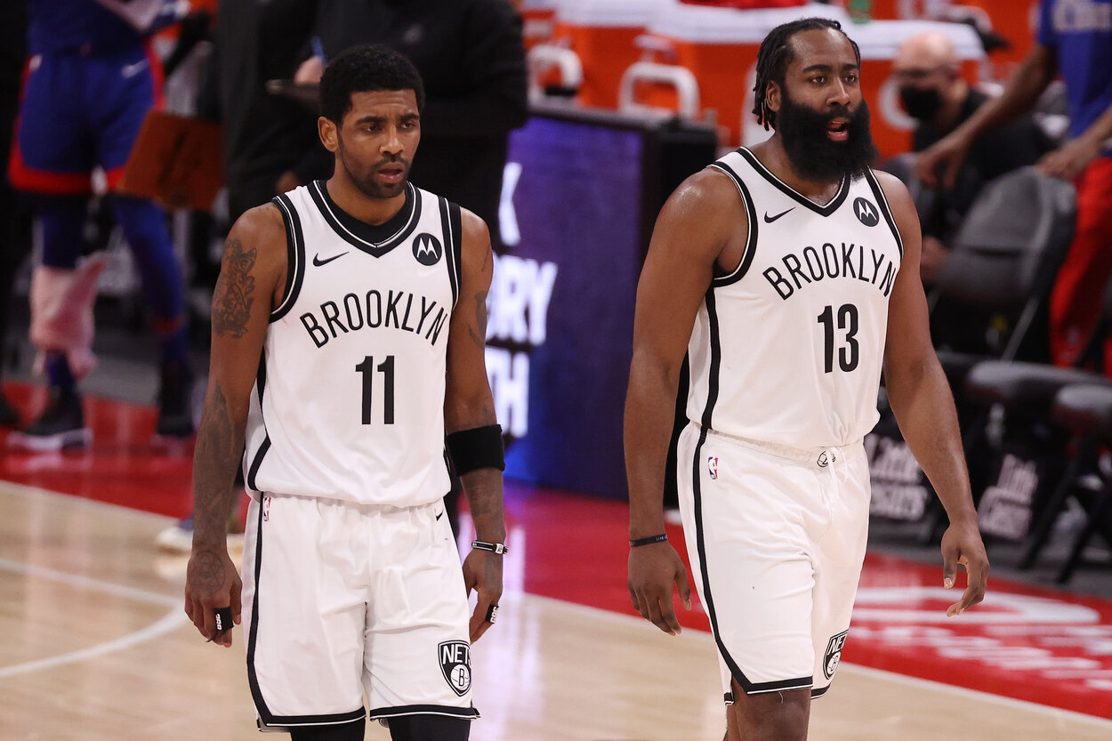Brooklyn Nets teammate Kyrie Irving (L) and James Harden during a 2021 game.