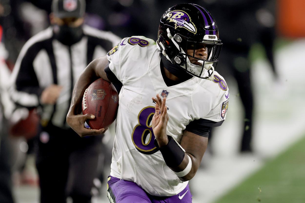 Baltimore Ravens quarterback Lamar Jackson runs the ball against the Browns.