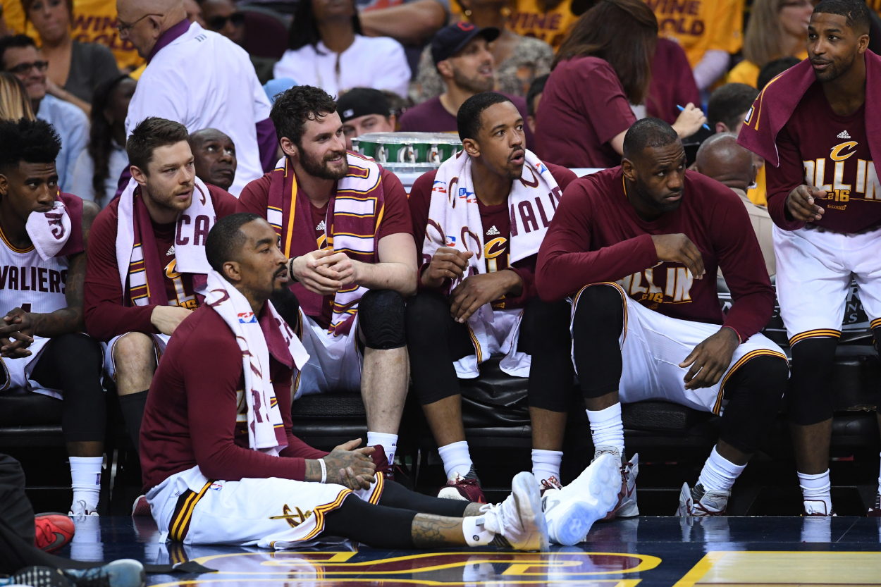 Iman Shumpert, Matthew Dellavedova, J.R. Smith, Kevin Love, Channing Frye, LeBron James, and Tristan Thompson of the Cleveland Cavaliers on the bench against the Raptors.