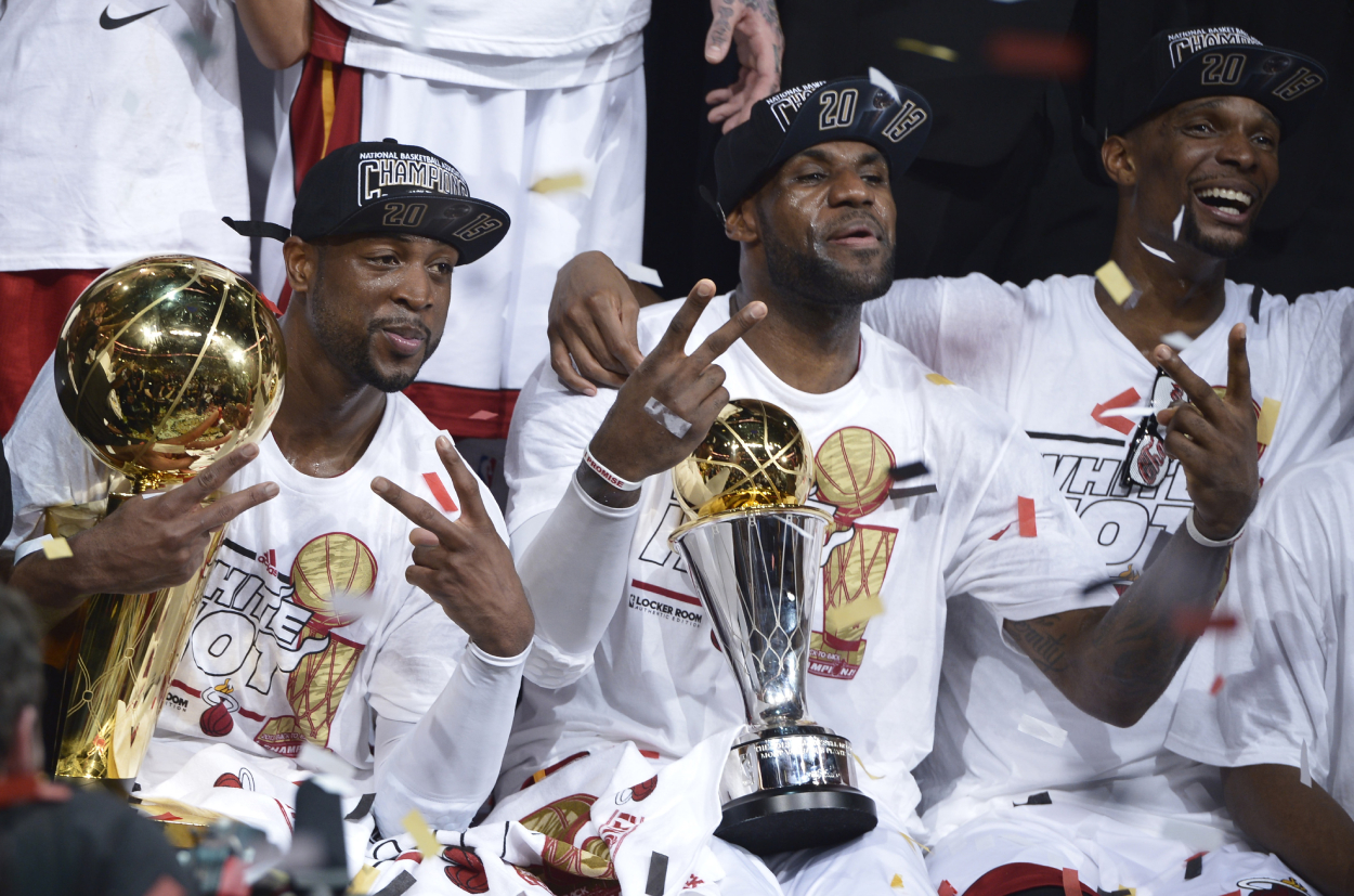 Dwyane Wade, LeBron James, and Chris Bosh celebrating a championship on the Miami Heat.