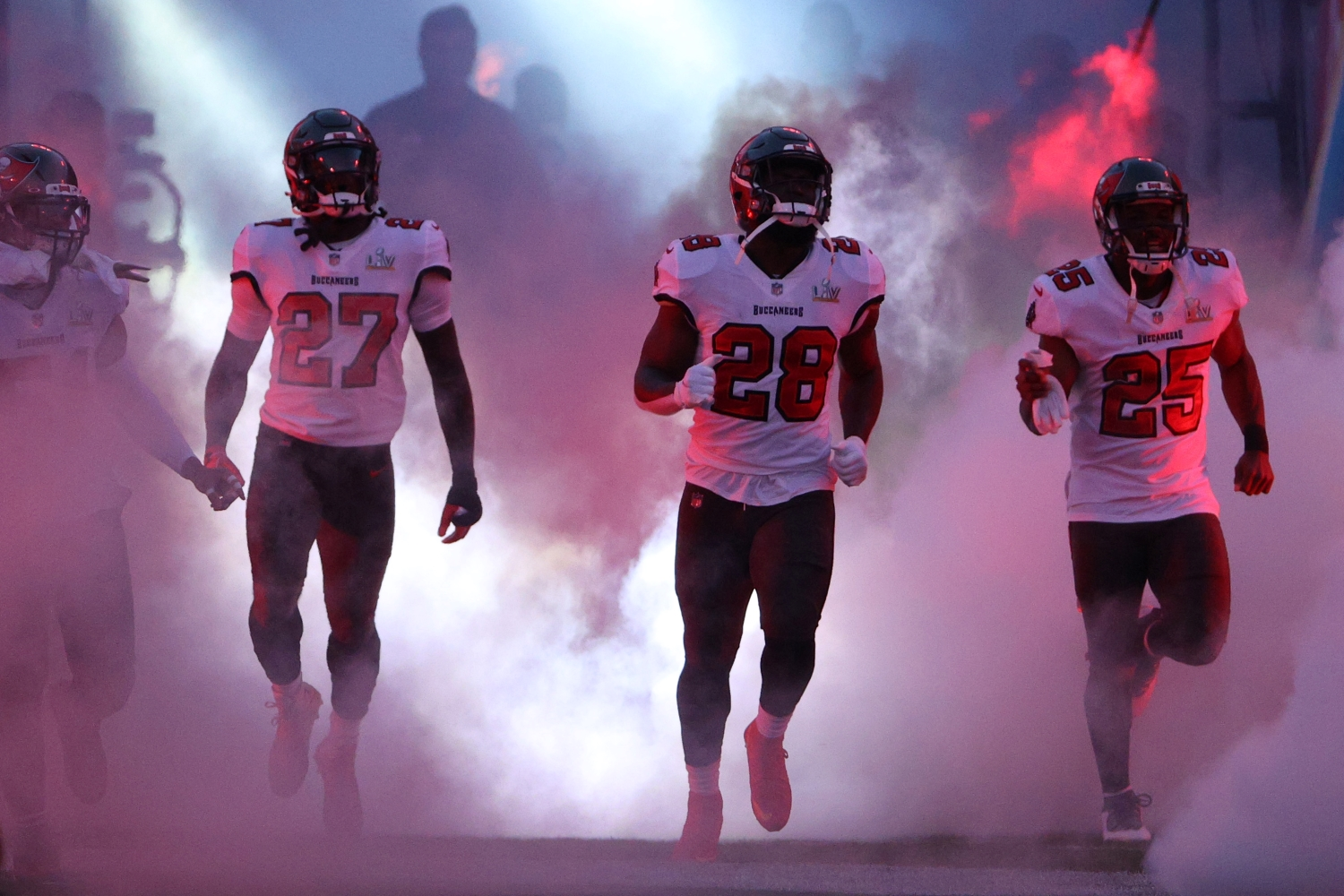 Ronald Jones, Leonard Fournette, and LeSean McCoy of the Tampa Bay Buccaneers take the field before Super Bowl 55.