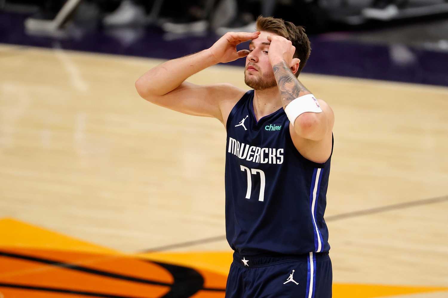 Luka Doncic of the Dallas Mavericks reacts to a foul call during the second half of the NBA game against the Phoenix Suns.