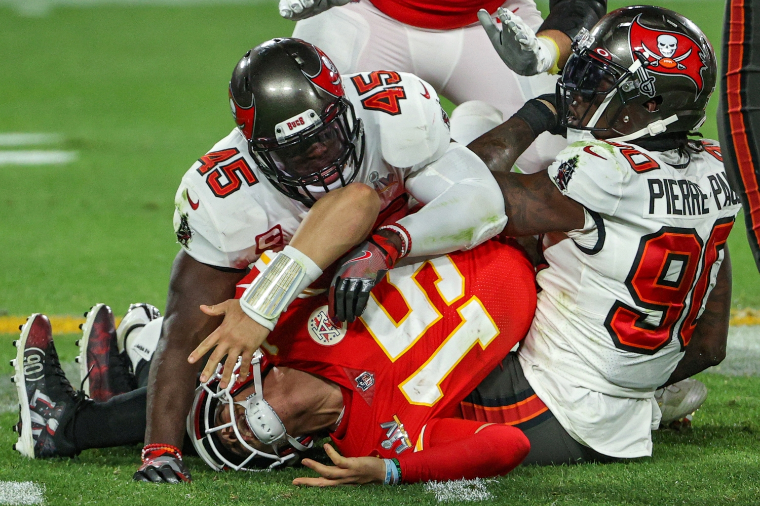 Chiefs quarterback Patrick Mahomes gets sacked by Buccaneers defenders Jason Pierre-Paul and Devin White in Super Bowl 55.