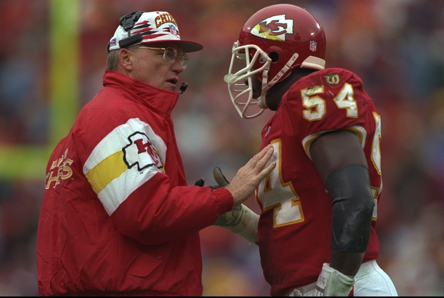 Head coach Marty Schottenheimer of the Kansas City Chiefs talks with his linebacker Tracy Simien during a game against the Green Bay Packers.