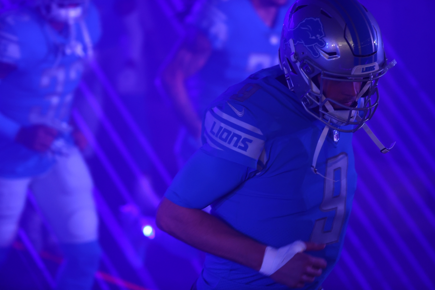 Matthew Stafford of the Detroit Lions takes the field before a game against the Minnesota Vikings.
