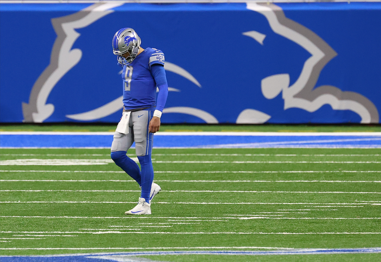 Former Detroit Lions quarterback Matthew Stafford walks off Ford Field against the Minnesota Vikings