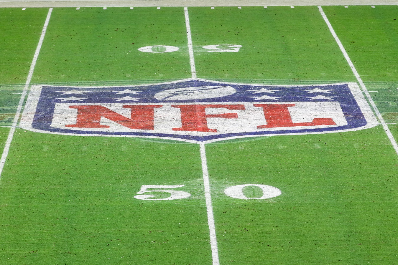 The NFL shield logo painted at the 50-yard line