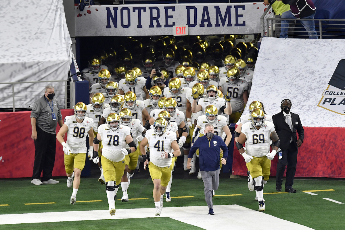 The Notre Dame Fighting Irish Football team prepares to take the field