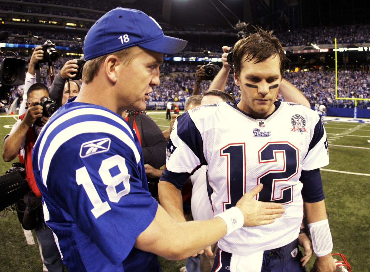 Peyton Manning talks to Tom Brady after a Colts' win over the Patriots.