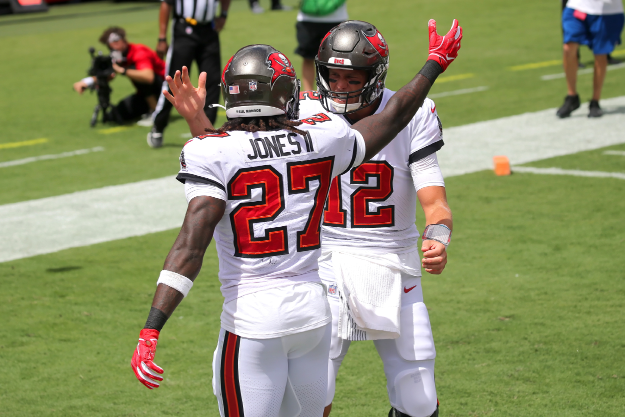 Buccaneers running back Ronald Jones celebrates a touchdown with Tom Brady.