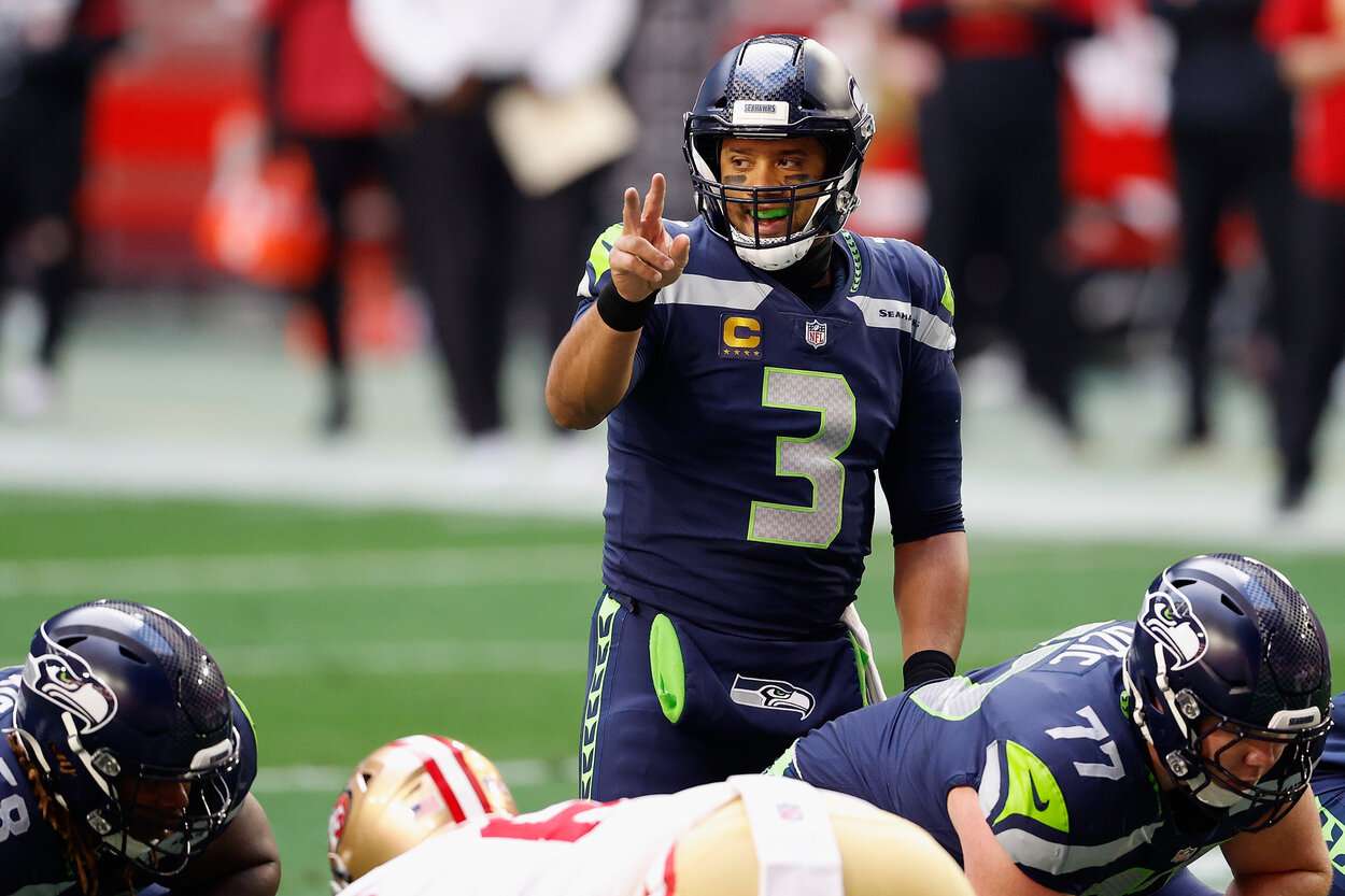Seattle Seahawks quarterback Russell Wilson stands at the line of scrimmage before a 2021 game against the San Francisco 49ers.