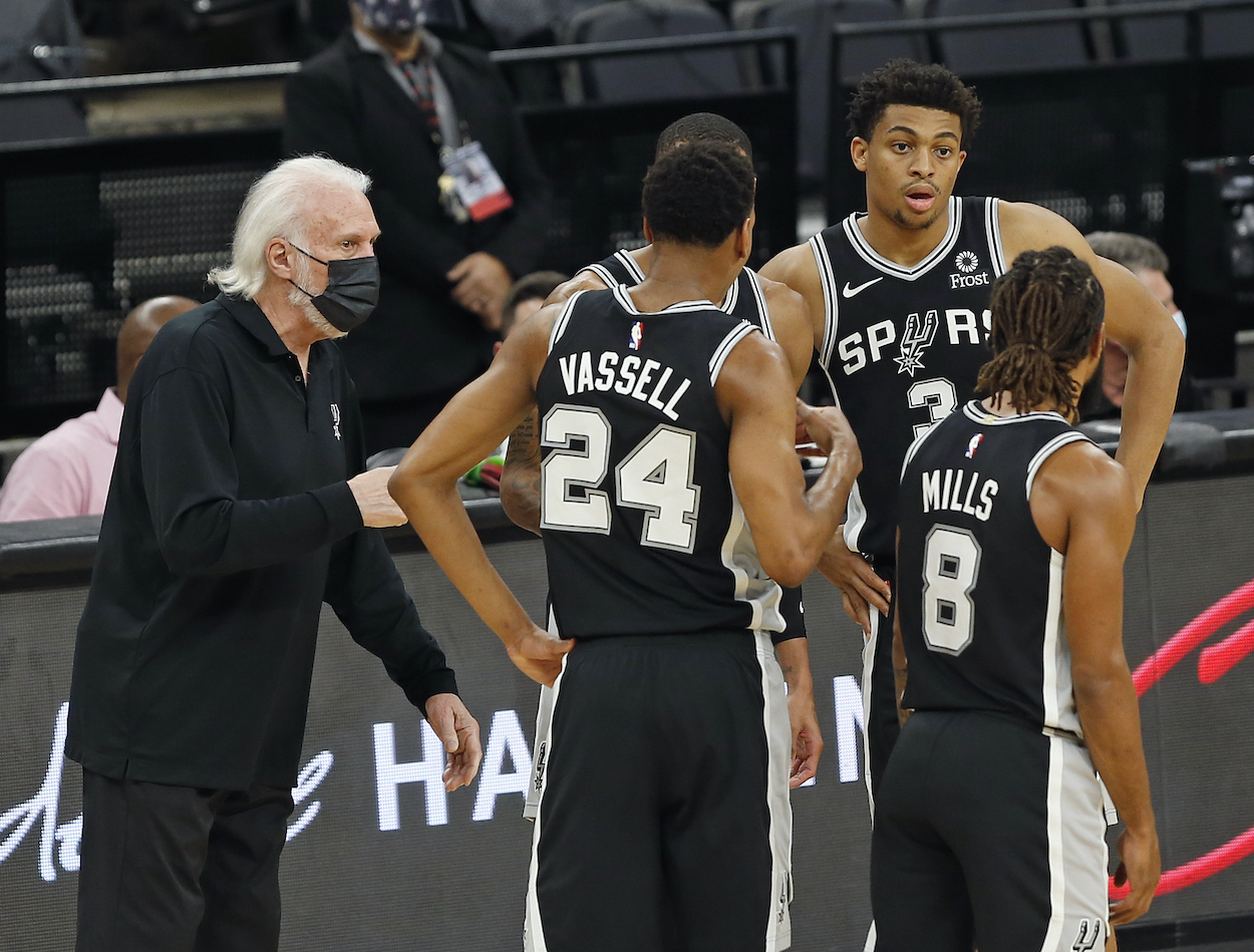 Gregg Popovich and the San Antonio Spurs huddle during a game against the Minnesota Timberwolves