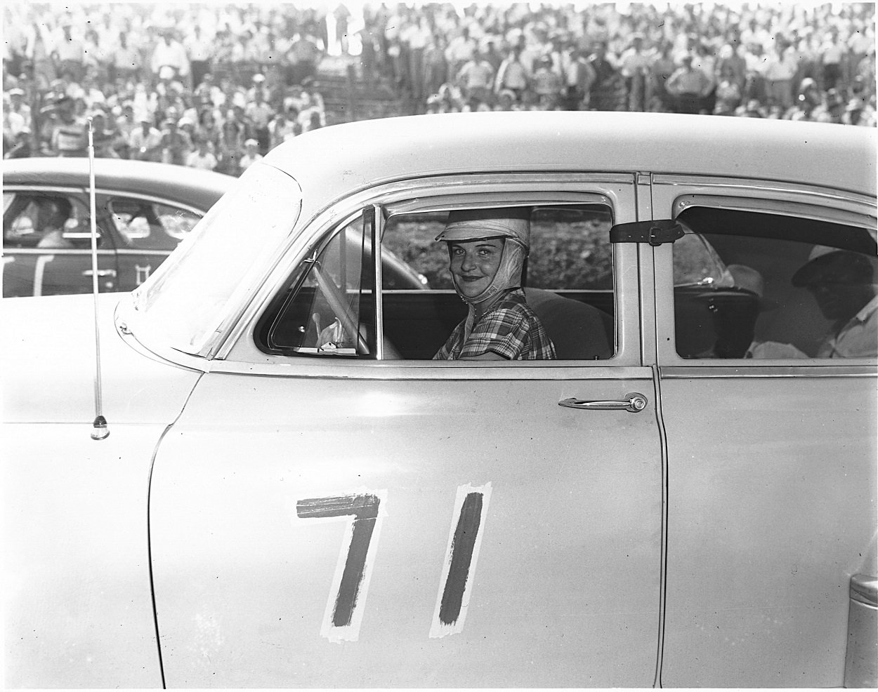 Sara Christian prepares for a 1949 NASCAR race