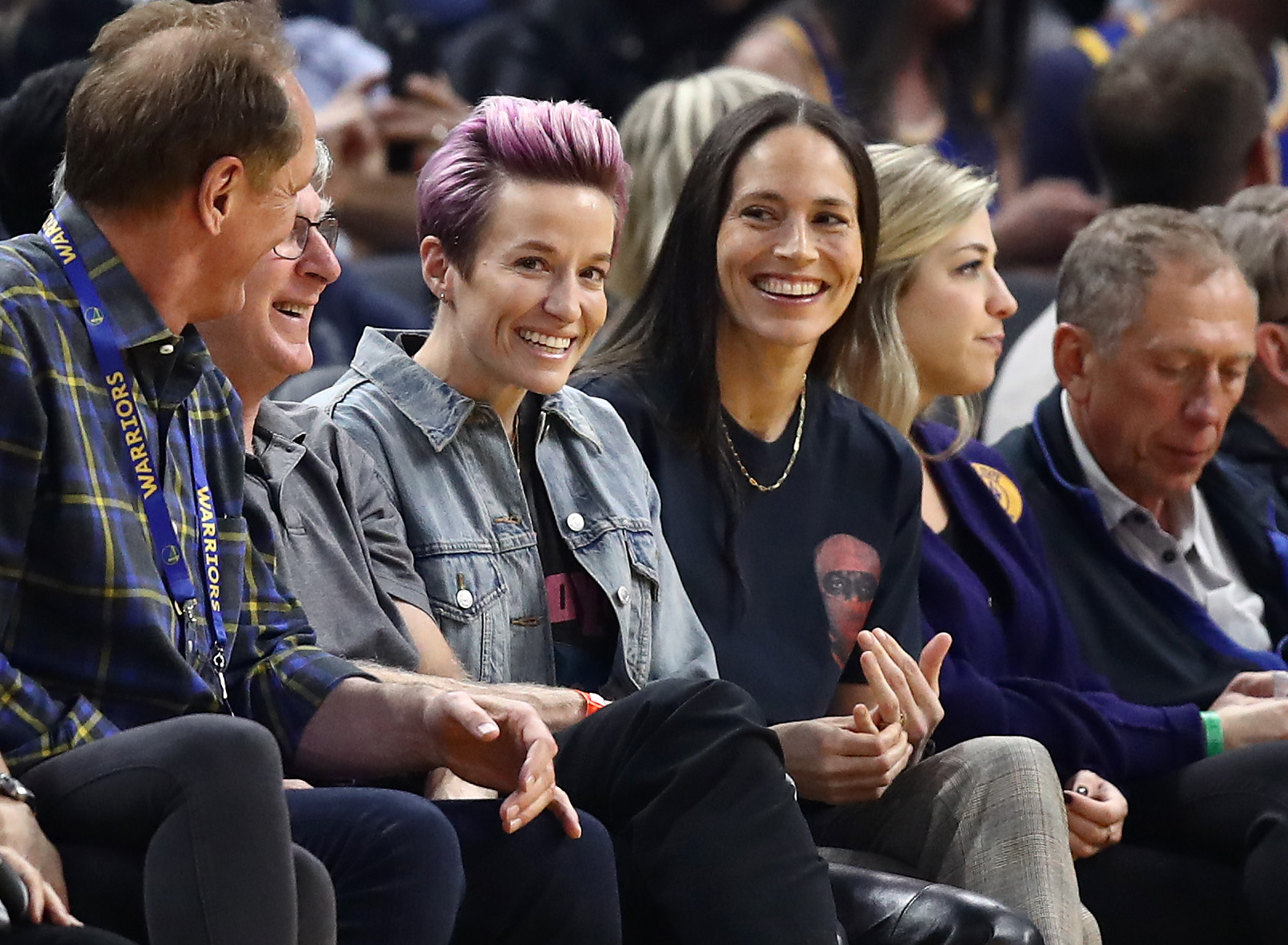 Sports power couple Megan Rapinoe and WNBA star Sue Bird watch an NBA game