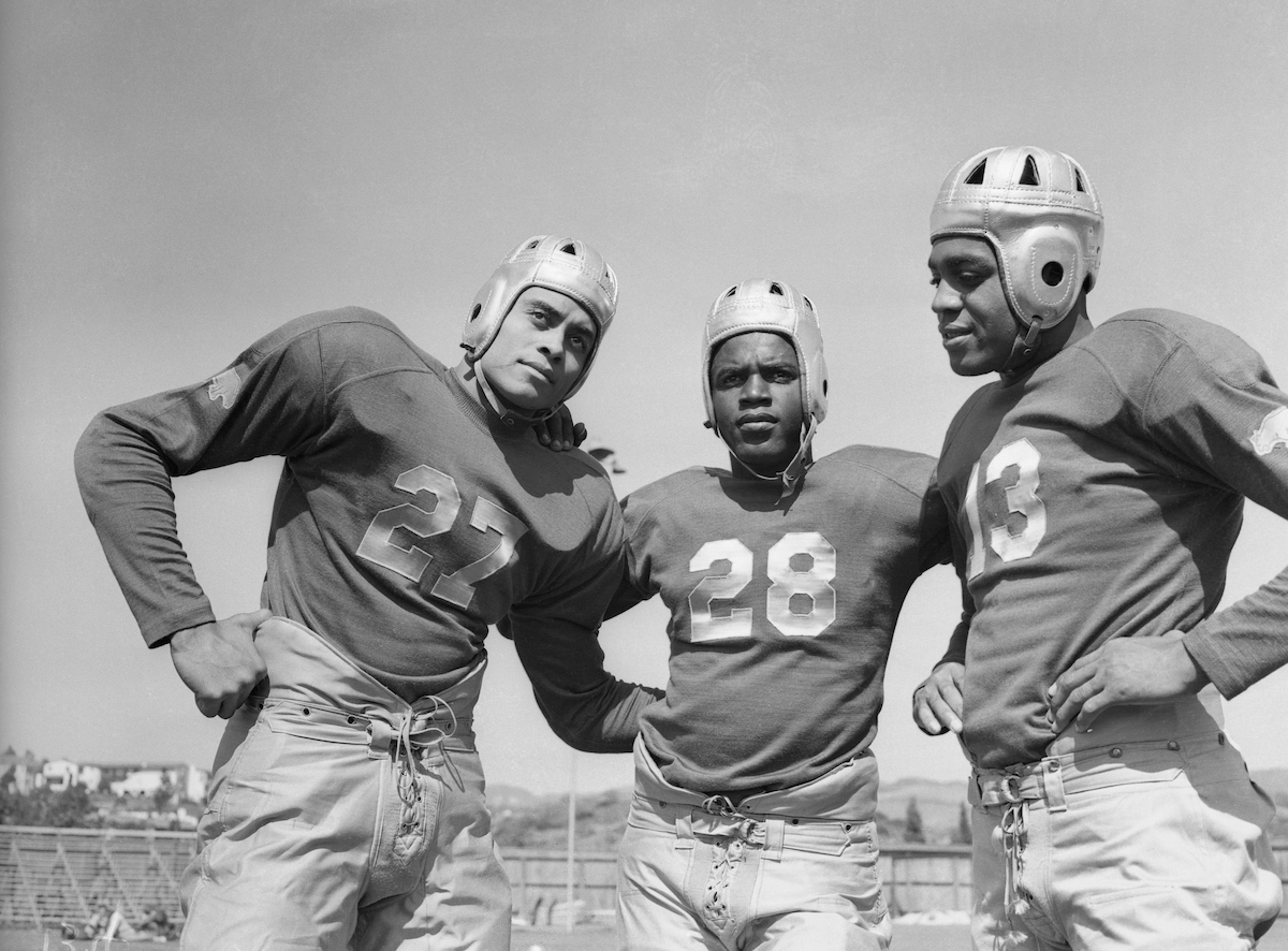 Woody Strode, Jackie Robinson, and Kenny Washington pose for a picture