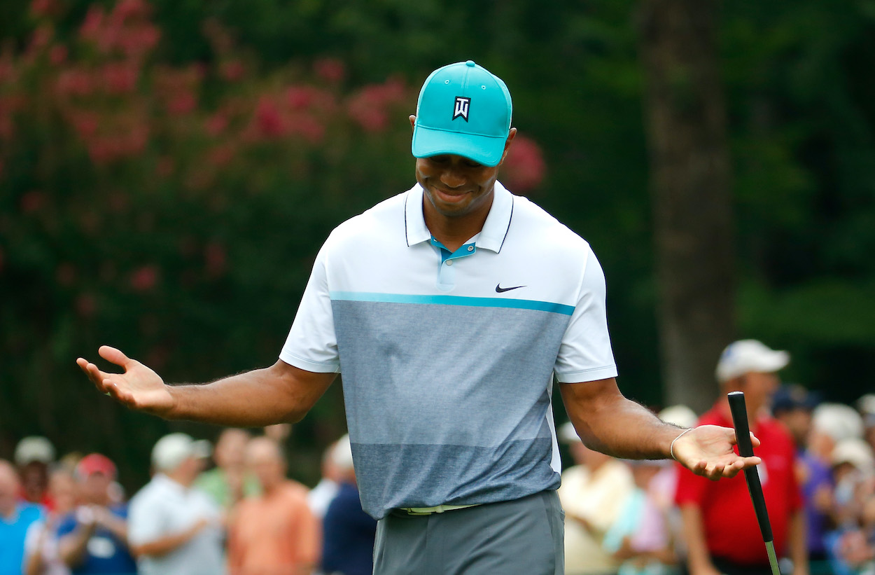 Tiger Woods shrugs after making a birdie putt at the 2015 Wyndham Championship