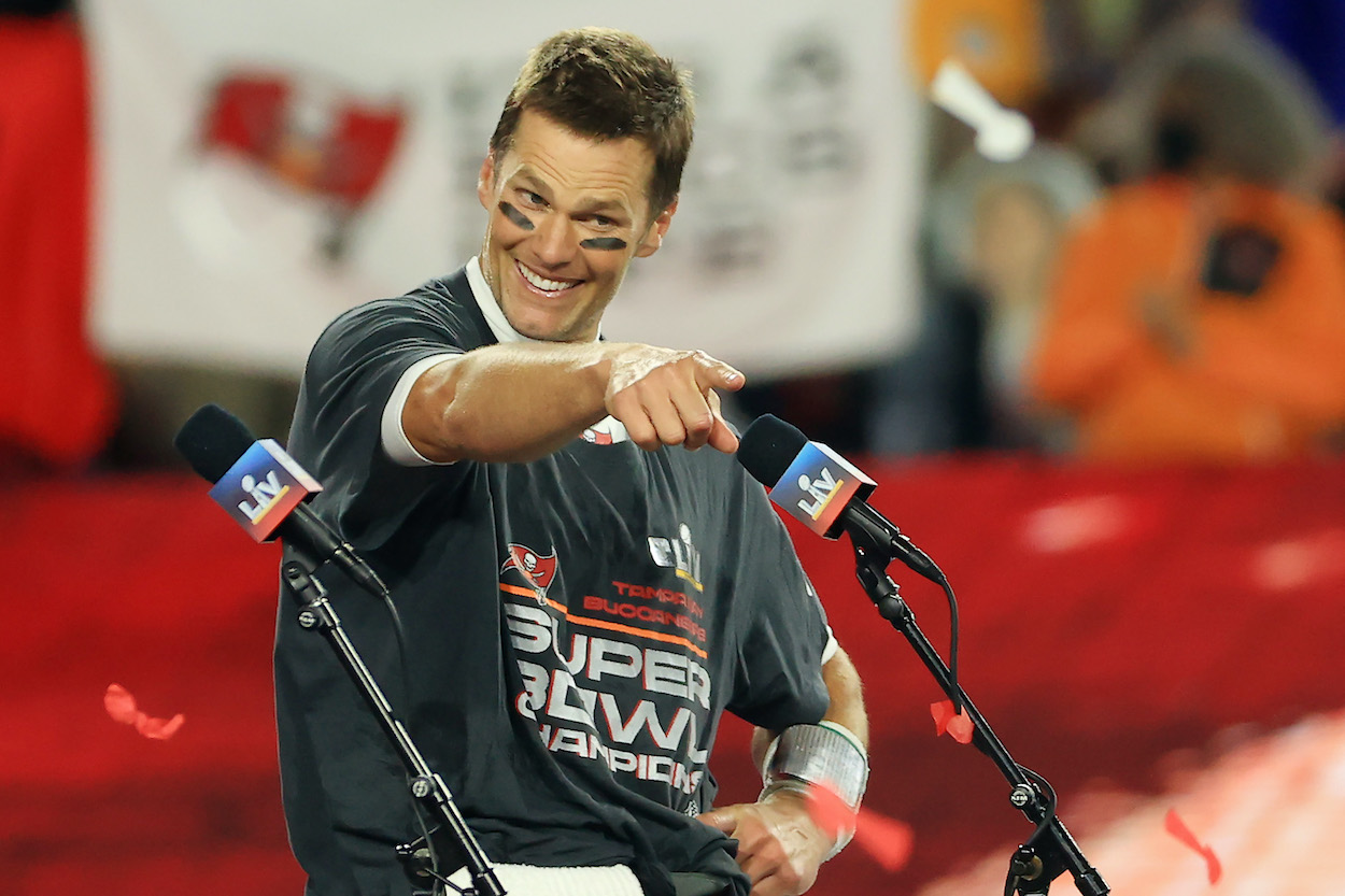 Tampa Bay Buccaneers quarterback Tom Brady points in the direction of a teammate after Super Bowl 55