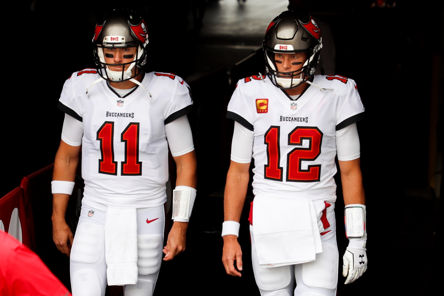 Tom Brady and Blaine Gabbert of the Tampa Bay Buccaneers enter the field before the start of a game against the Los Angeles Chargers.