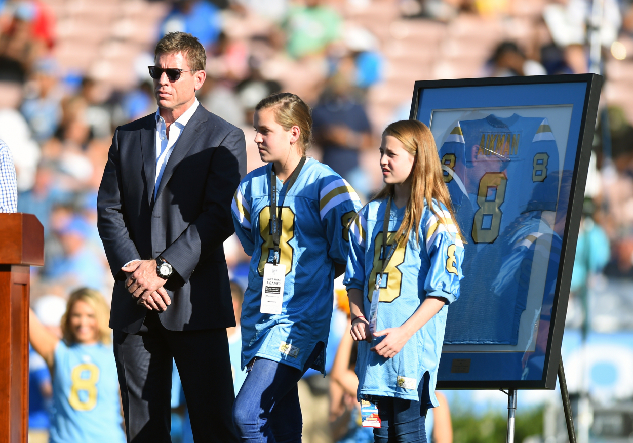Troy Aikman stands next to his daughters during ceremony at UCLA