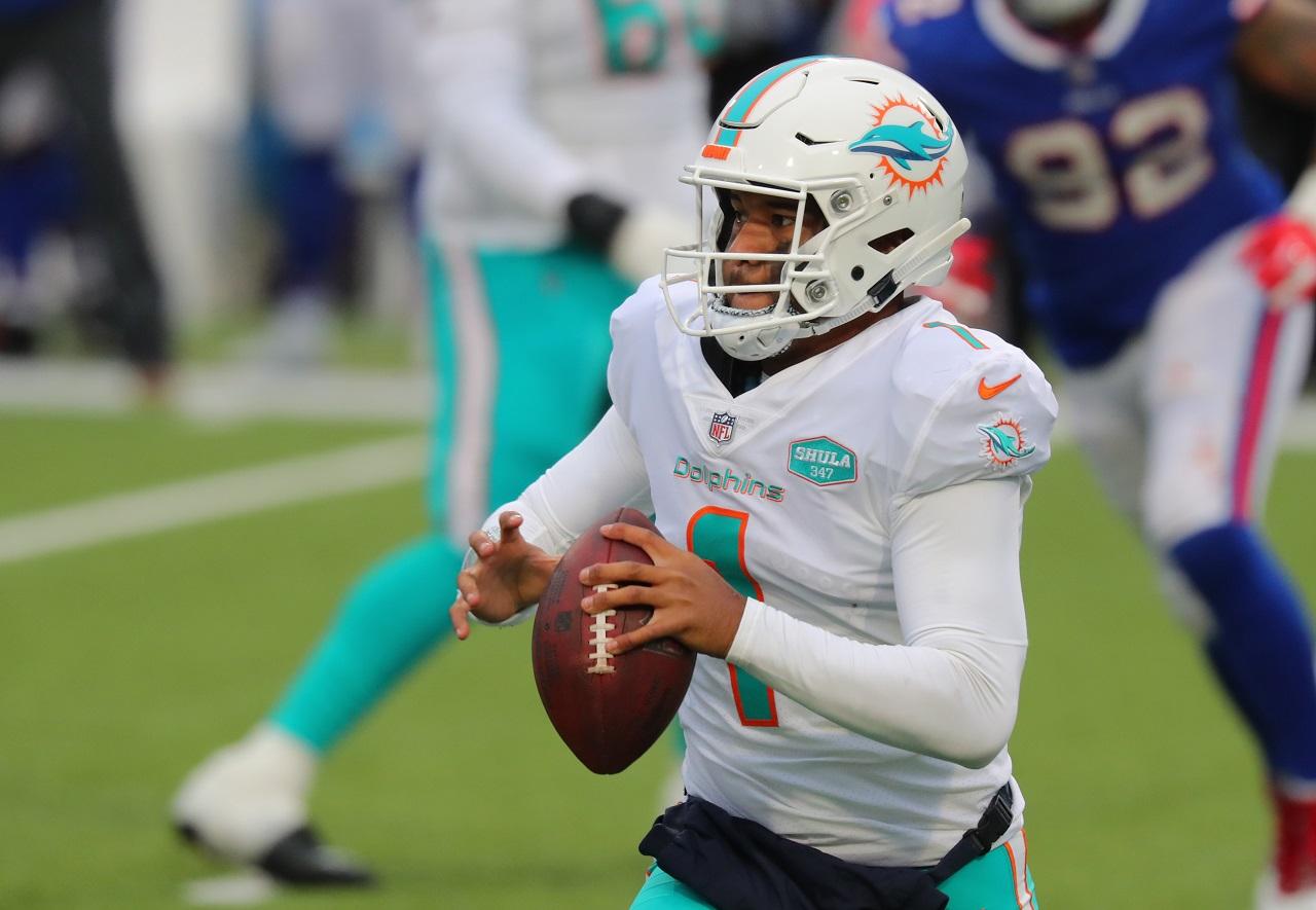 Miami Dolphins QB Tua Tagovailoa scrambling from the pocket