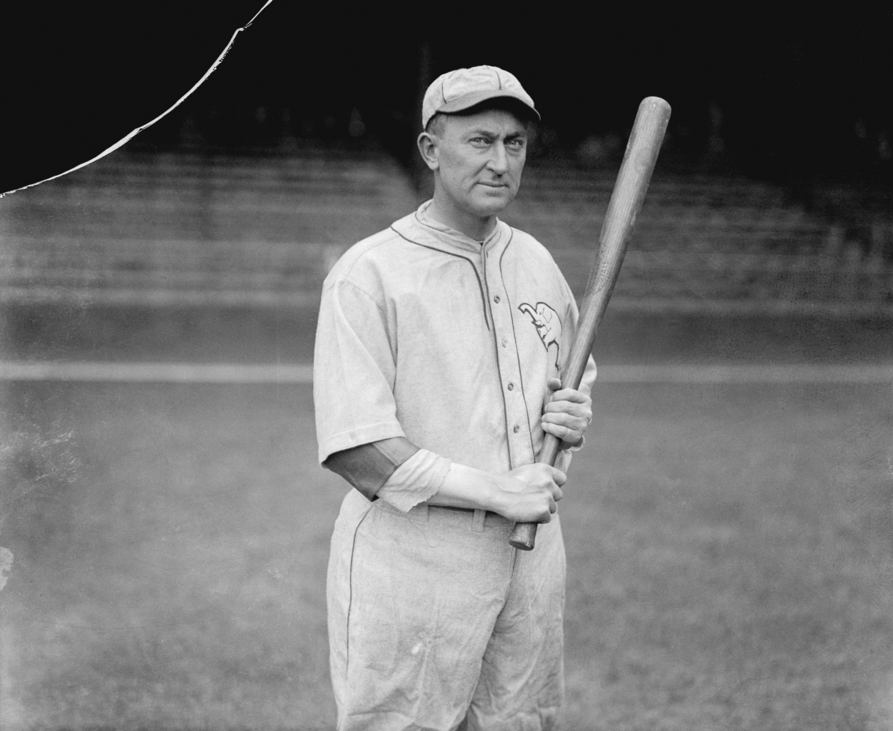 Ty Cobb poses for a photo while holding a bat