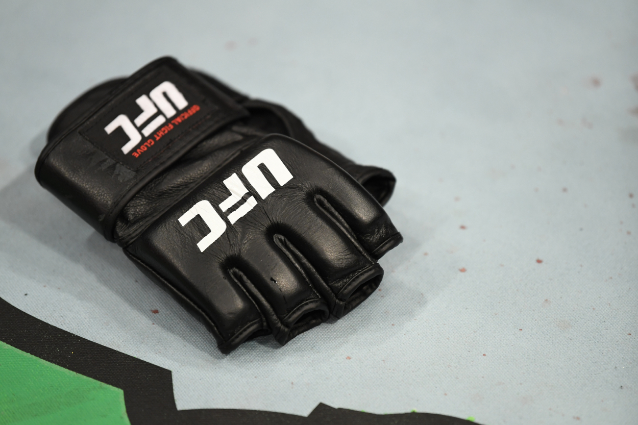 A UFC glove lying inside the ring