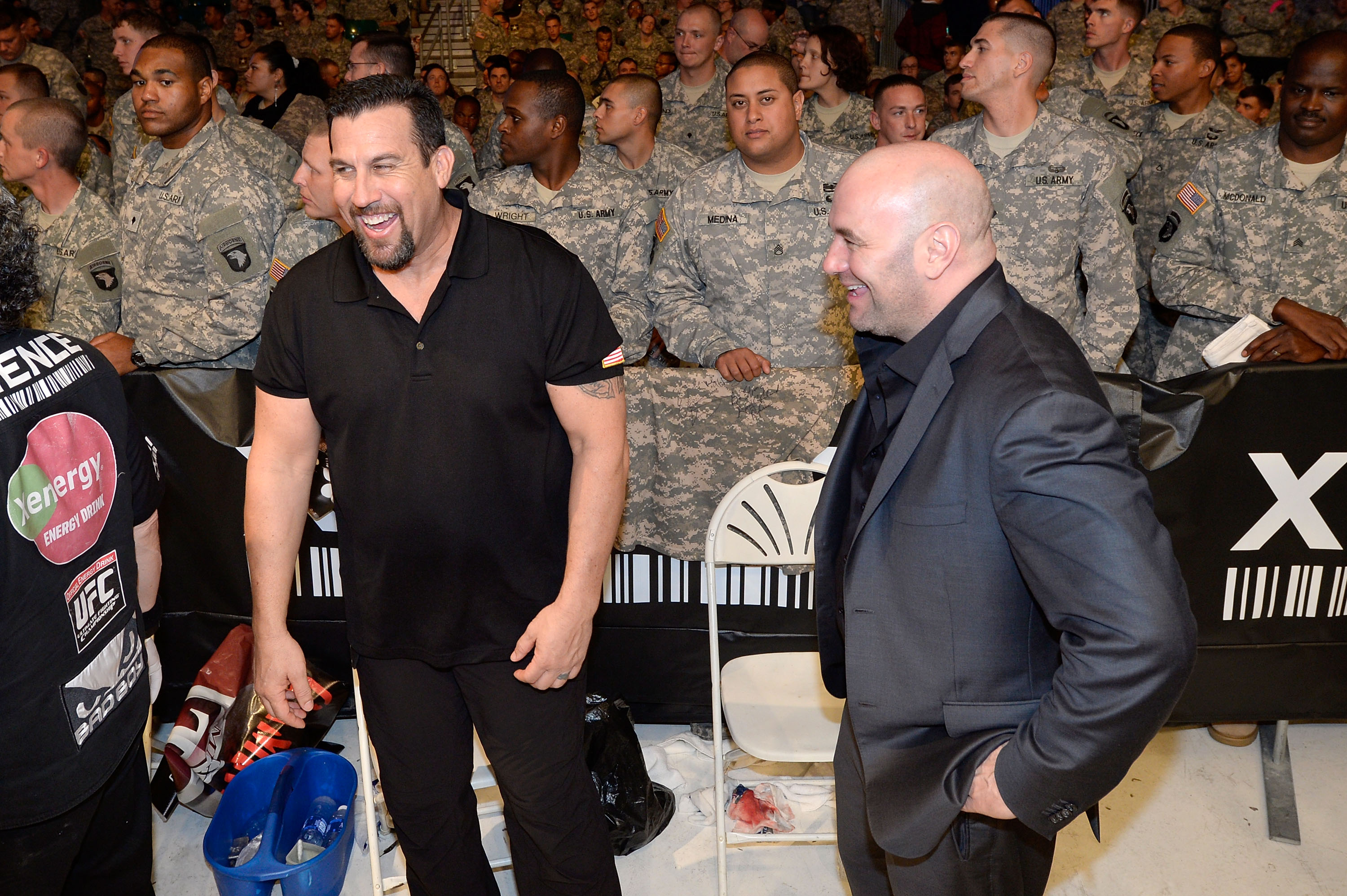 UFC President Dana White laughs with referee John McCarthy in 2013