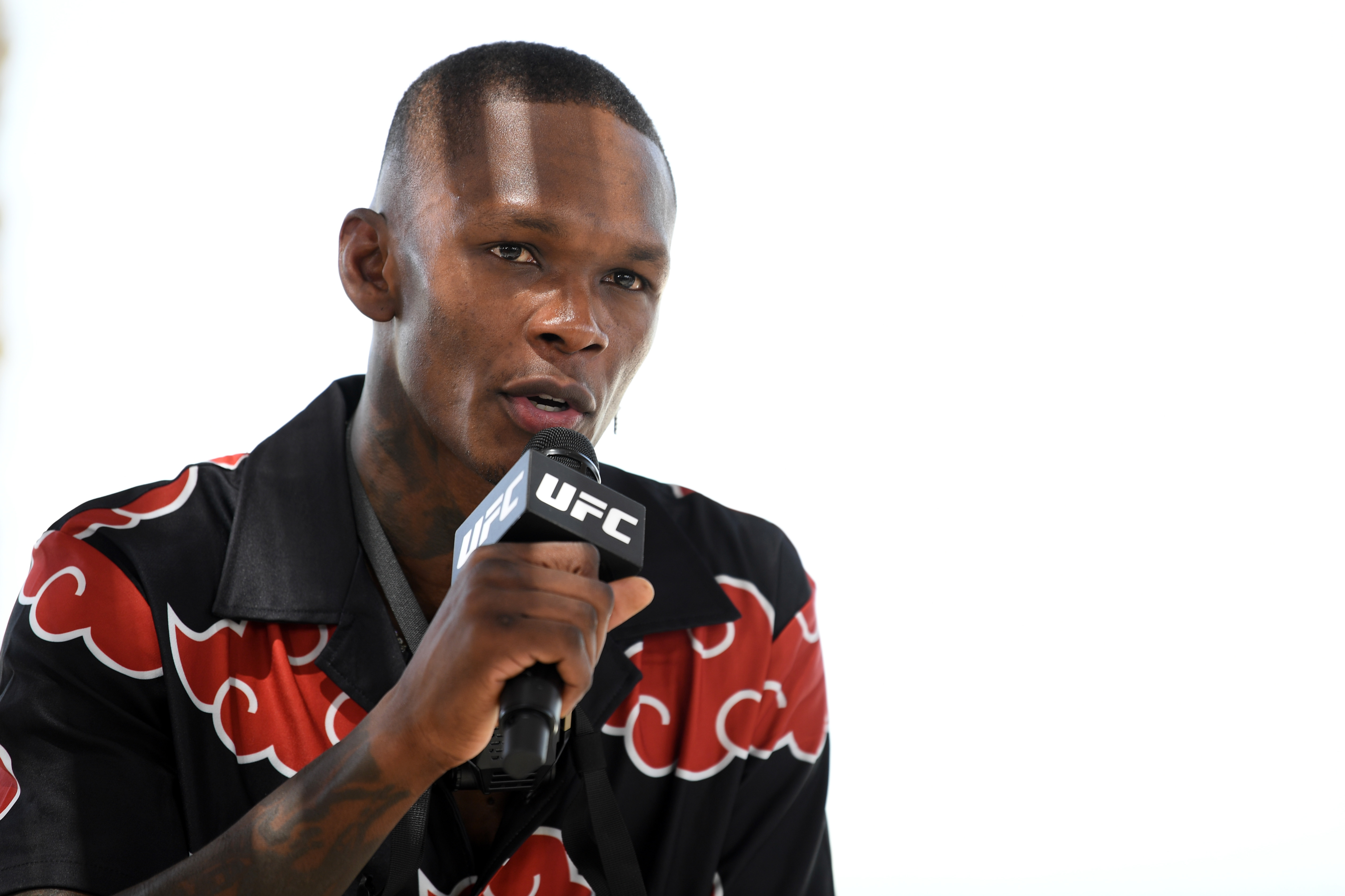 Israel Adesanya interacts with media
