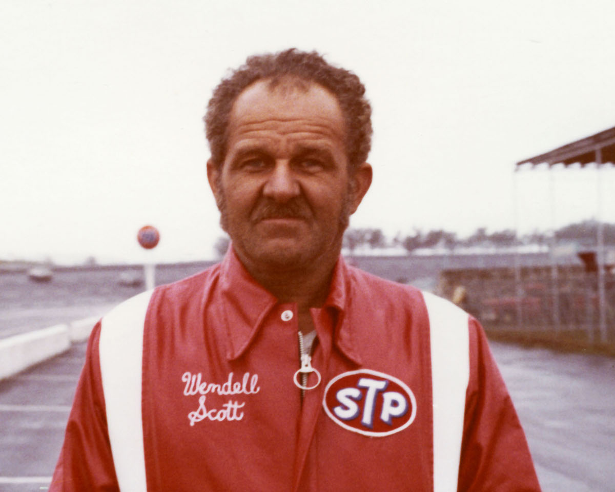 NASCAR driver Wendell Scott is posing for a portrait