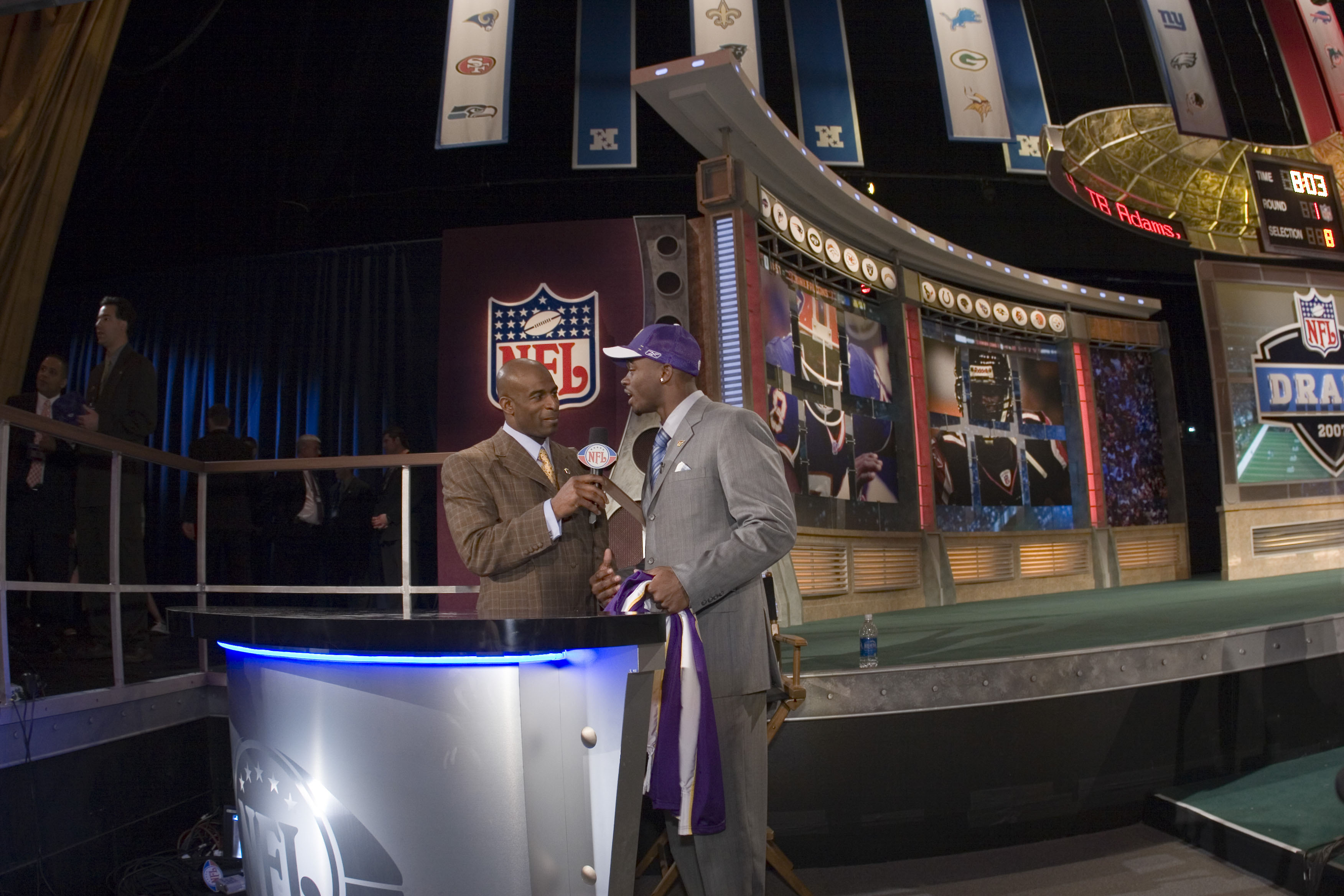 Adrian Peterson celebrates his selection by the Vikings at the 2007 NFL draft