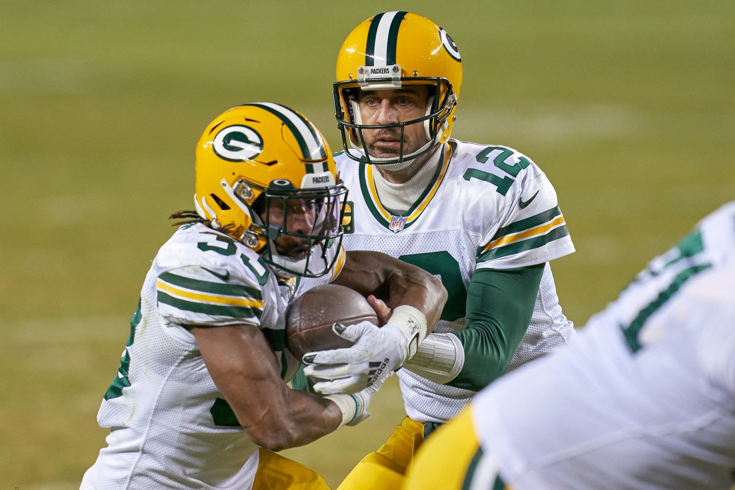 Aaron Rodgers hands the ball off to Packers RB Aaron Jones during a game against the Chicago Bears from the 2020 season.