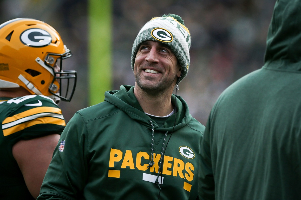 Aaron Rodgers stands on the sideline during a regular season game.