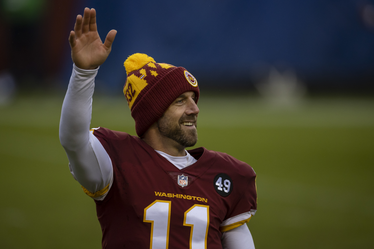 Alex Smith waves to football fans after a game