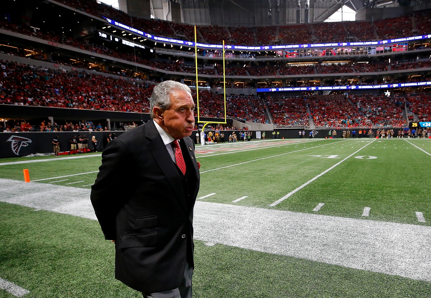 Atlanta Falcons owner Arthur Blank walks the sidelines during a game against the Miami Dolphins from the 2017 NFL season.