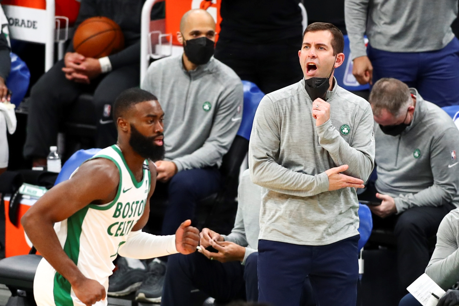 Head Coach Brad Stevens of the Boston Celtics lowers his mask to speak during a game against the Los Angeles Clippers at TD Garden on March 2, 2021.