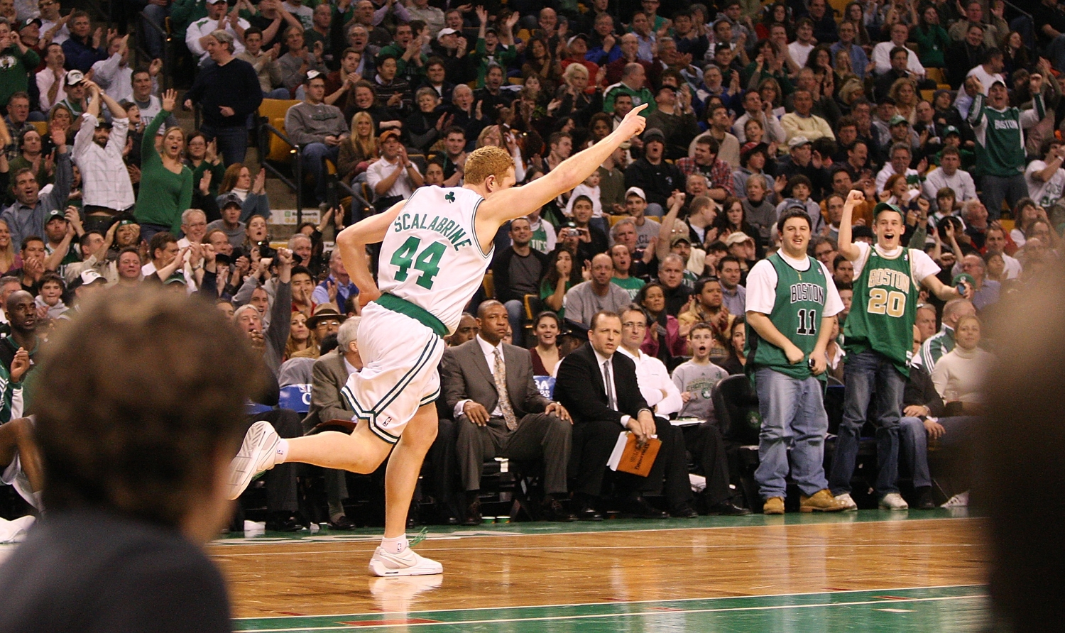 Brian Scalabrine celebrates as he runs down the court as a member of the Boston Celtics.