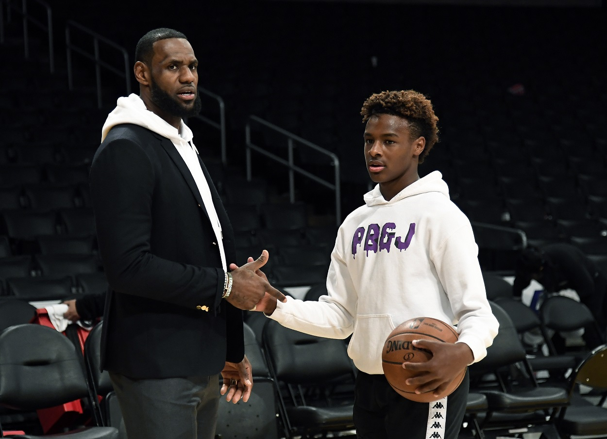 Bronny James and LeBron James interact after a game