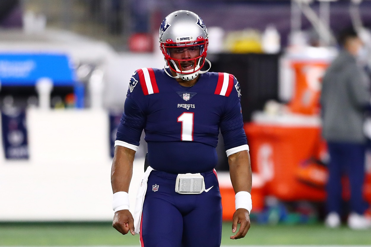 Patriots quarterback Cam Newton takes the field during warmups last season.