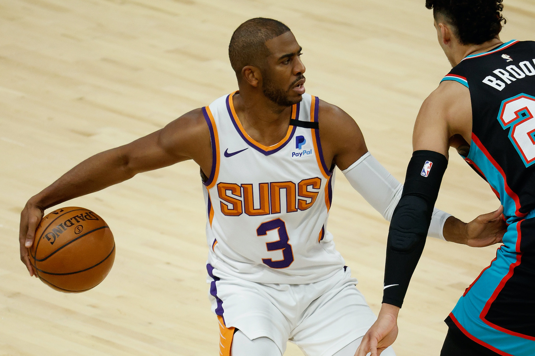 Phoenix Suns guard Chris Paul dribbles the ball up the court