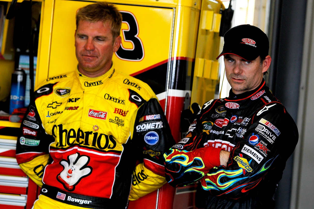 Former NASCAR drivers Clint Bowyer and Jeff Gordon ahead of a race in 2011