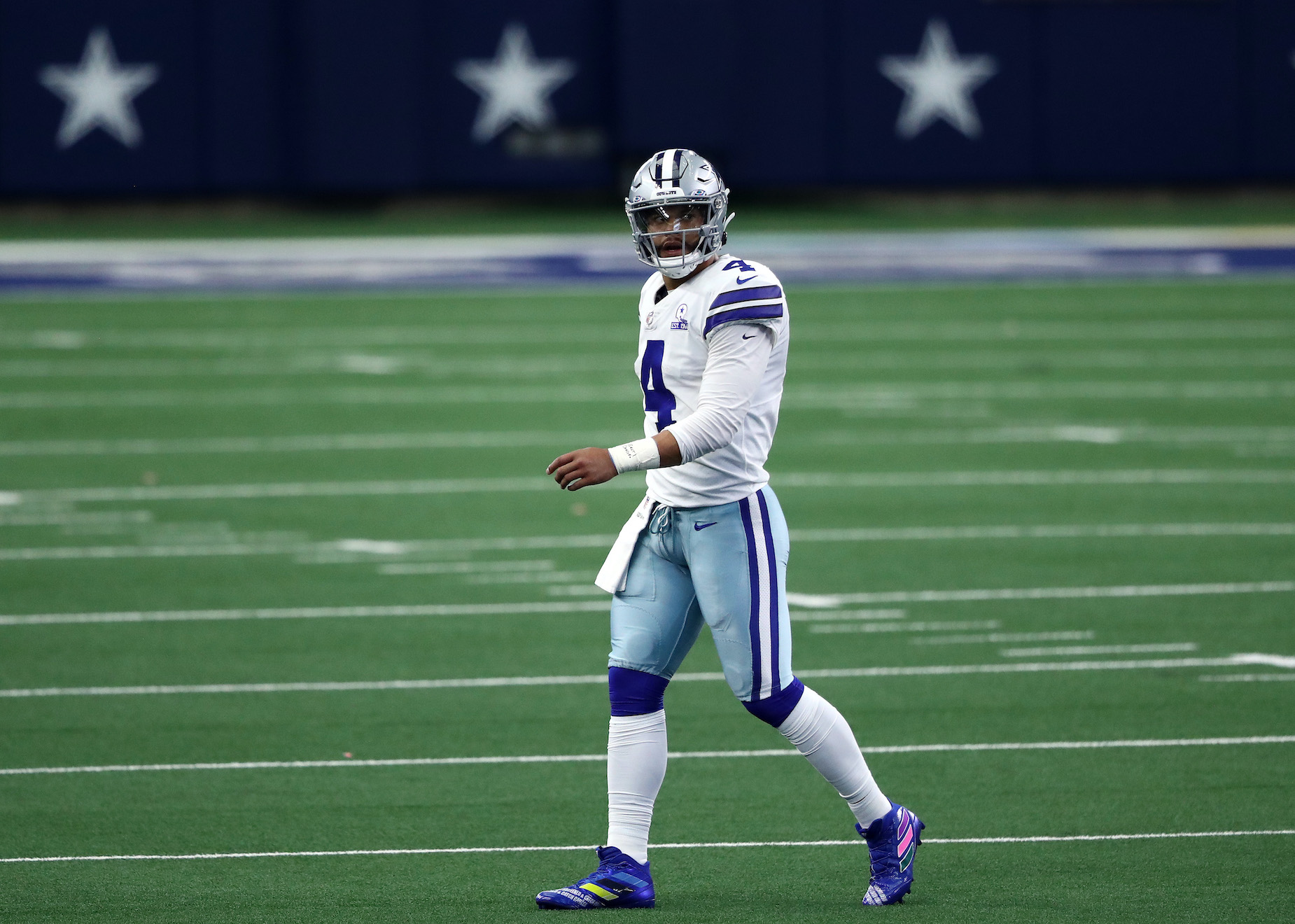 Dallas Cowboy quarterback Dak Prescott walks off the field.
