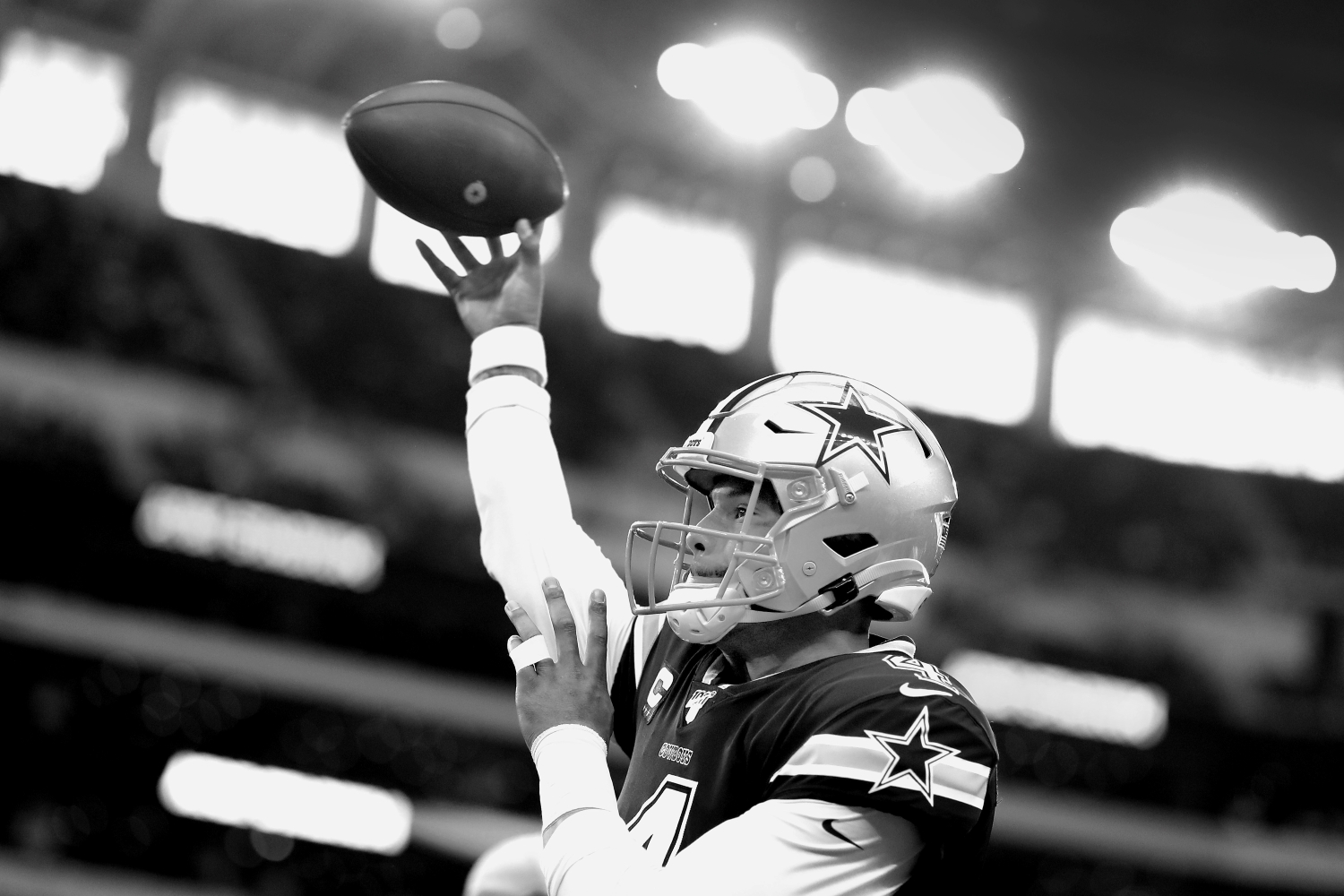 Dak Prescott warms up for the Dallas Cowboys before a game against the LA Rams in 2019.